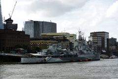 HMS Belfast cruiser on River Thames in London city in 19. September 2018. UK. HMS Belfast cruiser on River Thames in London city in 19. September 2018. United royalty free stock image