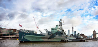 HMS Belfast. Scenic view of HMS Belfast moored on river Thames with cloudscape background, London royalty free stock photography