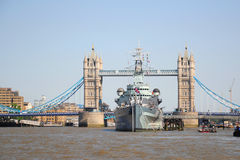 HMS Belfast ship near Tower Bridge, London. Front view of The HMS Belfast navy museum ship with The Tower Bridge in the background, London, United Kingdom Royalty Free Stock Photo