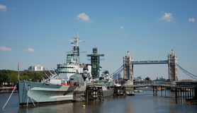 HMS Belfast and Tower Bridge. The museum ship HMS Belfast on the River Thames in London, with Tower Bridge in the background Stock Images