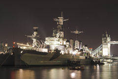 HMS Belfast Tower bridge. At night Royalty Free Stock Images
