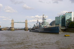 HMS Belfast and Tower Bridge. Two of Londons attractions along the river Thames Royalty Free Stock Photo