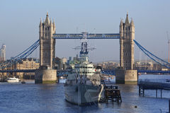 HMS Belfast - Tower Bridge - London - England. Tower Bridge (built 1886-1894) is a combined bascule and suspension bridge in London, England, over the River Royalty Free Stock Photo