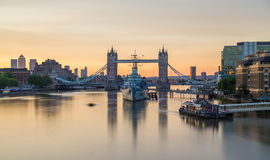 HMS Belfast and Tower Bridge in the morning Royalty Free Stock Photos