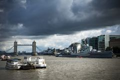 HMS Belfast and Tower Bridge under moody skies Stock Image