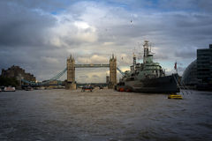 The hms belfast and the tower bridge Stock Images