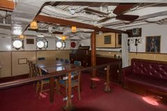 HMS Cavalier Wardroom. The Wardroom of HMS Cavalier a retired C-class destroyer of the Royal Navy royalty free stock photography