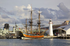 HMS Endeavour Replica. A replica of James Cook's HMS Endeavour, moored alongside the Australian National Maritime Museum in Darling Harbour, Sydney, is one of Stock Photos