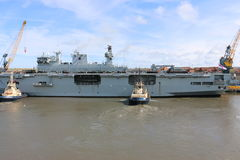 HMS Ocean arriving at Sunderland, 1st May 2015. The Royal Navy Amphibious Assault Ship HMS Ocean arriving on the River Wear on 1st May 2015. Svitzer Tugs Tyne Stock Images