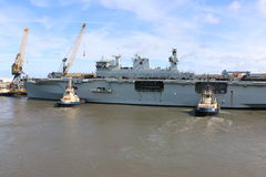 HMS Ocean arriving at Sunderland, 1st May 2015. The Royal Navy Amphibious Assault Ship HMS Ocean arriving on the River Wear on 1st May 2015. Svitzer Tugs Tyne Royalty Free Stock Photo
