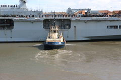 HMS Ocean arriving at Sunderland, 1st May 2015. The Royal Navy Amphibious Assault Ship HMS Ocean arriving on the River Wear on 1st May 2015. Svitzer Tugs Tyne Royalty Free Stock Photography