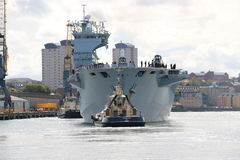 HMS Ocean arriving at Sunderland, 1st May 2015. The Royal Navy Amphibious Assault Ship HMS Ocean arriving on the River Wear on 1st May 2015. Svitzer Tugs Tyne Stock Photo