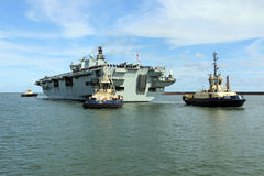 HMS Ocean arriving at Sunderland, 1st May 2015. The Royal Navy Amphibious Assault Ship HMS Ocean arriving on the River Wear on 1st May 2015. Svitzer Tugs Tyne Royalty Free Stock Photos