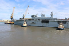 HMS Ocean arriving at Sunderland, 1st May 2015. The Royal Navy Amphibious Assault Ship HMS Ocean arriving on the River Wear on 1st May 2015. Svitzer Tugs Tyne Stock Photos