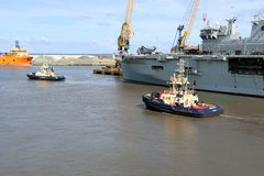 HMS Ocean arriving at Sunderland, 1st May 2015. The Royal Navy Amphibious Assault Ship HMS Ocean arriving on the River Wear on 1st May 2015. Svitzer Tugs Tyne Stock Image