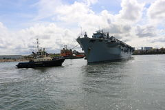 HMS Ocean arriving at Sunderland, 1st May 2015. The Royal Navy Amphibious Assault Ship HMS Ocean arriving on the River Wear on 1st May 2015. Svitzer Tugs Tyne Royalty Free Stock Images