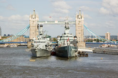HMS Portland and HMS Belfast at Tower Bridge Stock Photo