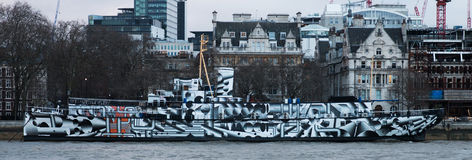 HMS President 1918. First World War sloop, now known as HMS President 1918 and moored on the Thames Embankment, London, in wartime dazzle paint Stock Image