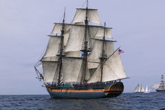 HMS Surprise sailing at sea under full sail. HMS Surprise Sailing Ship at Sea under full sail with tall ships in the background royalty free stock photography