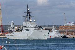 Two fisheries protection vessels in Portsmouth, UK. HMS Tyne Royal Navy departing Portsmouth Harbour to patrol the offshore fishing areas of the English Channel royalty free stock image
