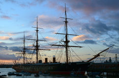 HMS Warrior. HMS Warrior moored in Portsmouth, England. HMS Warrior with her sister ship HMS Black Prince were the worlds first iron-clad warships. Image taken royalty free stock images