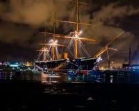 HMS Warrior at night Stock Photos