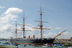 HMS Warrior, Portsmouth. HMS Warrior docked in Portsmouth, Hampshire. The first iron hulled armoured warship in the world and the fastest ship of her time. Now royalty free stock photography