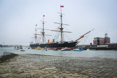 Hms warrior portsmouth naval dockyards uk. Hms warrior english navy victorian iron hulled war ship built in 1860 in the royal naval dockyards portsmouth england stock image