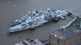 HMS Westminster Moored Alongside HMS Belfast On River Thames, London. Stock Photography