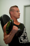 Hnadsome young man working out with dumbbells in fitness -  powe Stock Photo