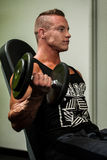 Hnadsome young man working out with dumbbells in fitness -  powe Royalty Free Stock Image