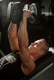 Hnadsome young man working out with dumbbells in fitness -  powe Stock Image
