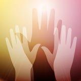 Hände in der Leuchte Stockbild