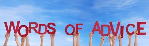Händer som rymmer ord av rådgivning Fotografering för Bildbyråer