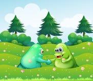 Händeschütteln mit zwei Monstern Stockbilder