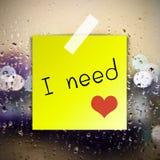 Ho bisogno dell'amore con il fondo delle gocce di acqua Fotografia Stock