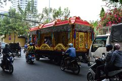 Ho chi minh City funeral. Vietnam - southern city of ho chi minh city or saigon  elaborate golden hearse driving through the city Stock Photography