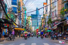 Ho Chi Minh City. HO CHI MINH - DECEMBER 1: Bui Vien Street backpackers` hotel area on December 1, 2016 in Ho Chi Minh, Vietnam. Scooter traffic in Saigon royalty free stock photography