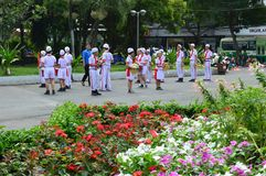 Ho chi minh City marching band prepares. Vietnam - southern city of ho chi minh city or saigon in a city park young people gather in marching bands or military Stock Images