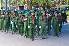 Ho chi minh City marching band prepares. Vietnam - southern city of ho chi minh city or saigon in a city park young people gather in marching bands or military Royalty Free Stock Image