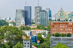 Ho Chi Minh City metropolis and downtown of Saigon, Vietnam. Ho Chi Minh City, Vietnam - 4 April, 2018: Ho Chi Minh City metropolis with Notre-Dame Cathedral stock photos