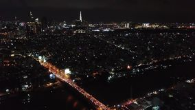 Ho Chi Minh City, Saigon, Vietnam, aerial footage, drone footage, beautiful architecture and visible traffic at night. Ho Chi Minh City, Saigon, Vietnam, aerial stock video footage