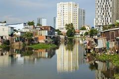 Ho Chi Minh City slums by river, Saigon, Vietnam Stock Images