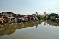 Ho Chi Minh City slums by river, Saigon, Vietnam Royalty Free Stock Images