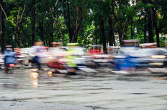 Ho Chi Minh City traffic on a wet afternoon Royalty Free Stock Photos