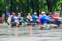 Ho Chi Minh City traffic on a wet afternoon Stock Photos