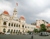 Ho Chi Minh City. Unidentified people passing in front of the City Hall building, Ho Chi Minh City, Vietnam Stock Image