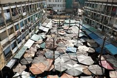 Outdoor market among old building. HO CHI MINH CITY, VIET NAM- AUG 8, 2017: Amazing panoramic from high view of outdoor market among old building, open air Stock Image
