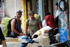 Caucasian man in backpacking travel. HO CHI MINH CITY, VIET NAM- DEC 2, 2017: Group of caucasian man in vacation by backpacking travel on Saigon street, male royalty free stock photography