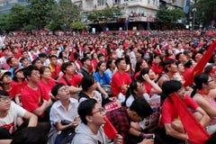 Vietnamese soccer supporters watch AFC U23 final match. HO CHI MINH CITY, VIET NAM- JAN 27, 2018:  Amazing with large crowd of Vietnamese soccer supporters Stock Photography